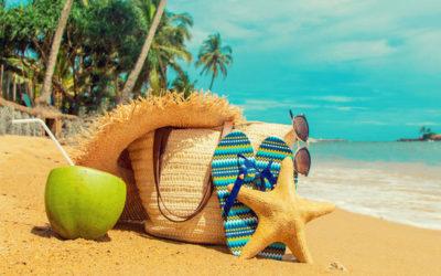 Beach bag and coconut on a beach